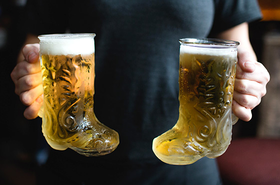 Two glass boots of beer